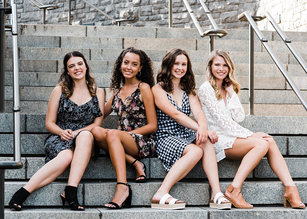 highschool senior girls having fun on the steps captured by happy valley photographer