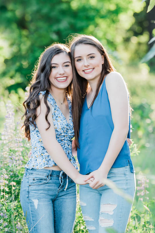 Happy Valley photographer photographs sisters in a field of flowers