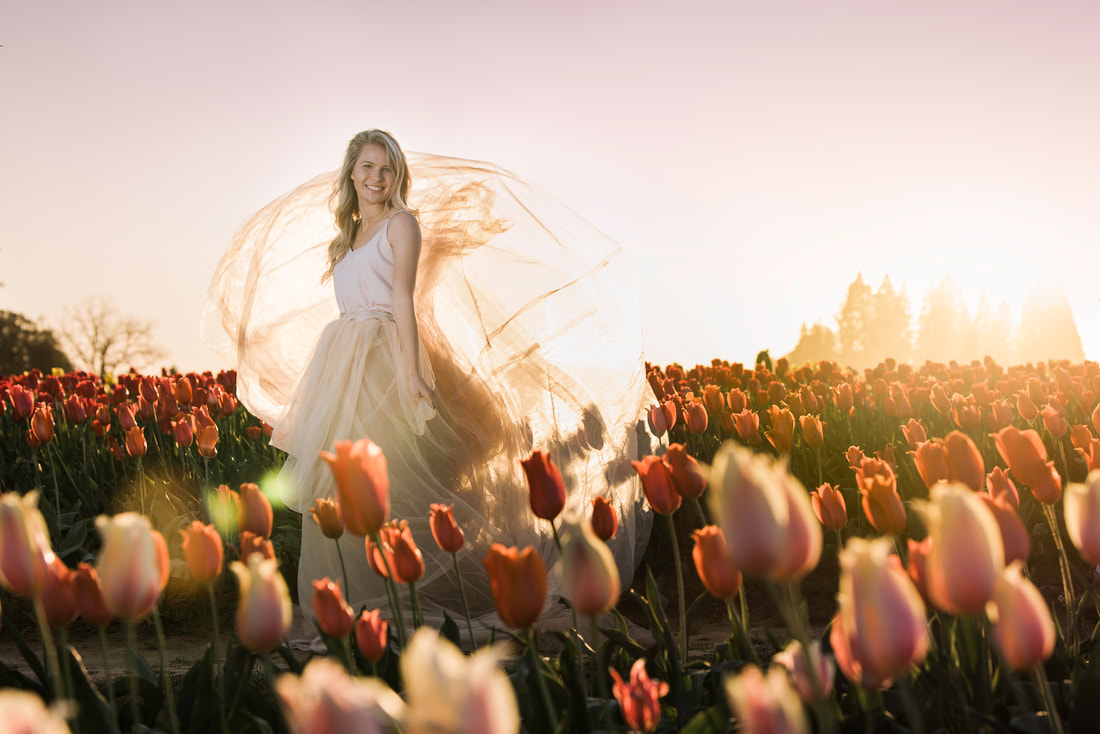 Happy Valley Senior photographer captures high school senior girl in a field of tulips