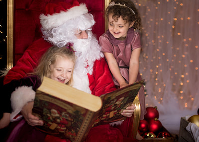 Happy Valley Photographer takes photo of happy girls with Santa