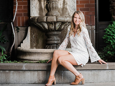 Clackamas High School Senior Photographer captures girl in front of a fountain